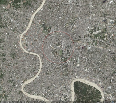 A Google Earth image of central Bangkok showing a red circle with an area of 3,493 acres.