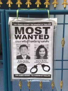 Fake wanted poster for Thaskin Shinatwara and his wife Pojaman.